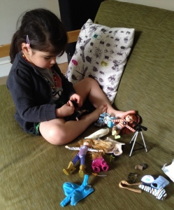 Lottie Dolls, little girl playing with dolls,