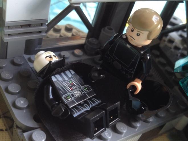 Vader removes helmet